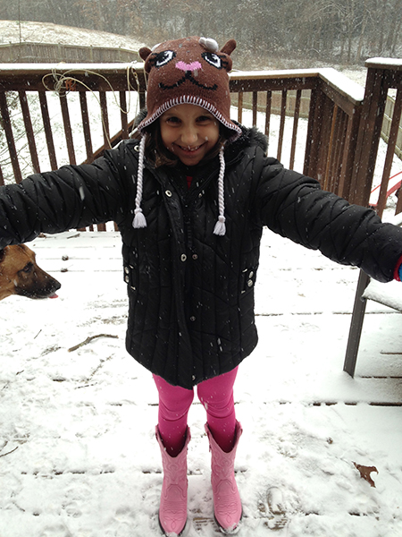 Antonia had to wear a hat and cowboy boots to protect her from the elements.